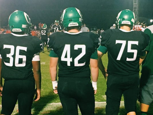 Parkside players watch from the sidelines