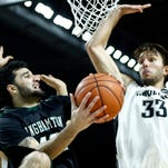 Binghamton forward Willie Rodriguez (42) shoots the ball against Providence Friars forward Carson Desrosiers (33) during the second half at Dunkin' Donuts Center in November 2014.