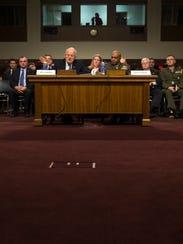 Director of National Intelligence James Clapper, left,
