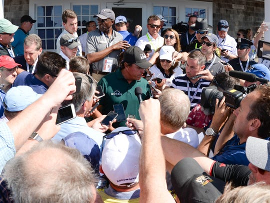 Phil Mickelson speaks to reporters after playing the