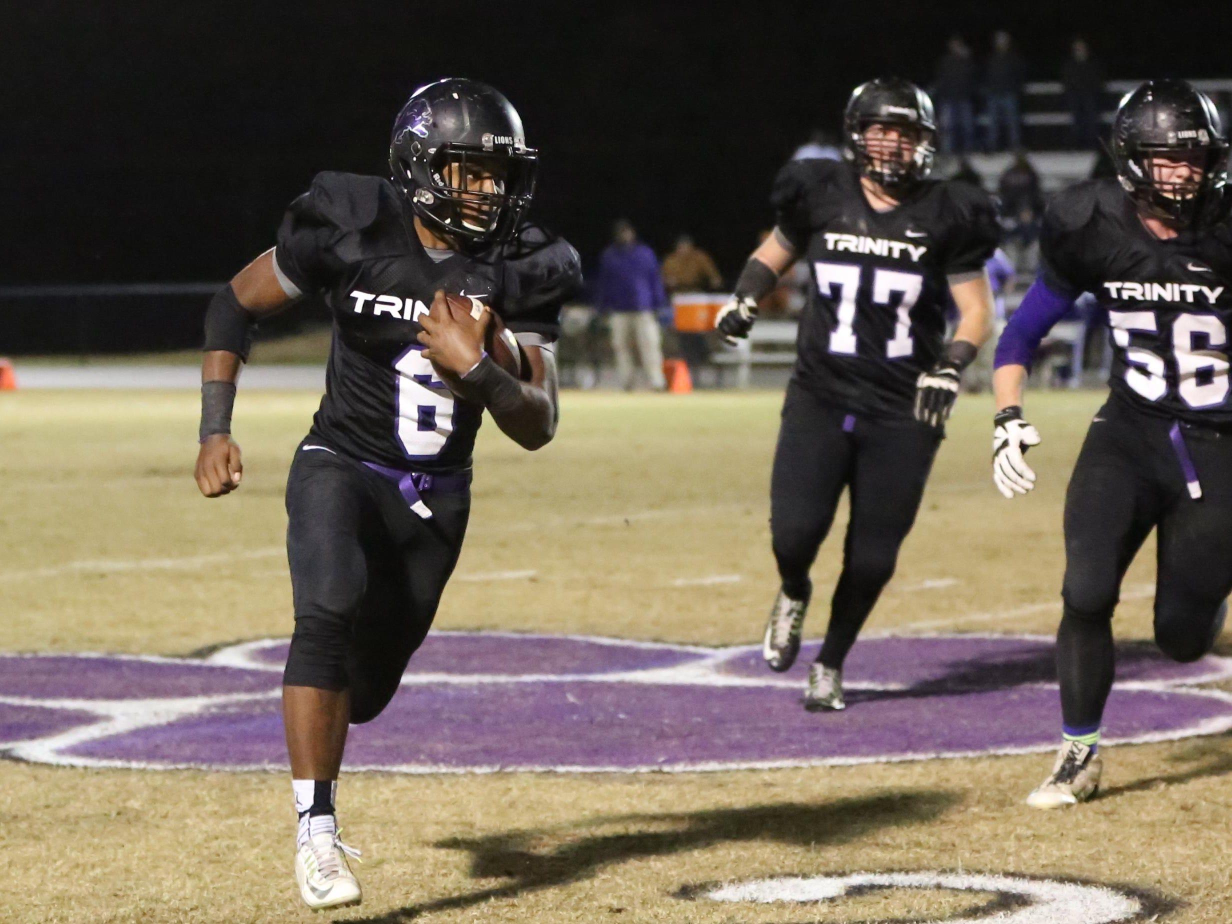 Trinity's Viktor Horton runs to the sideline to avoid the Trezevant defense Friday in the Class 2A semifinals at TCA.