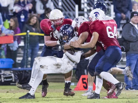 Strathmore defenders corral a Horizon Christian Academy ballcarrier during a CIF Regional Football Championship Bowl Game on Saturday, December 10, 2016.