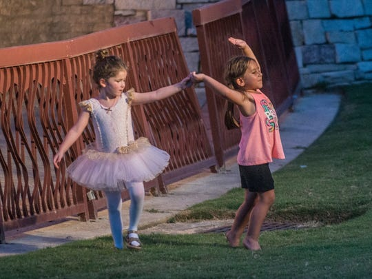 Makenna Cova, left, and Rylee Reeves, both five, dance on the grass during the performance. The Alabama Dance Theatre presented Stars on the Riverfront on July 29 ad 30, two days of free ballet at Montgomery's Riverwalk Amphitheater.