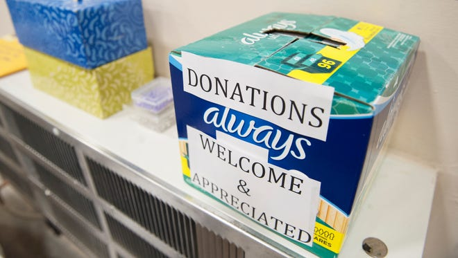 A donation box is displayed in the Cherry Hill warehouse of Distributing Dignity.   08.14.17