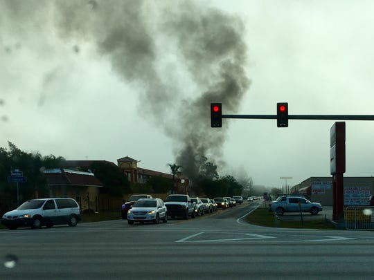 A vehicle fire sent plumes of black smoke into U.S