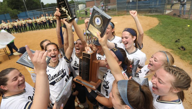 Ramsey celebrates with their trophy as they became the Bergen County Softball Championship for the second year in a row. Monday, May 28, 2018
