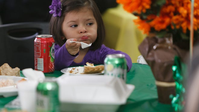 Community members enjoy traditional Thanksgiving fare at the Red Rock Canyon School's annual free community Thanksgiving dinner Thursday, Nov. 27, 2014.