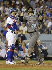 Arizona Diamondbacks' J.D. Martinez reacts after hitting a home run against the Los Angeles Dodgers in the 6th inning during Game 1 of the NLDS on Friday Oct. 6, 2017 at Dodger Stadium in Los Angeles, California.