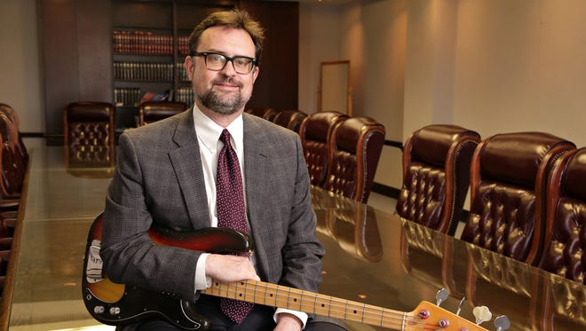 Before he became an Arizona appellate judge, Peter Swann was a bass guitar-playing teenager in New York who, with his friend Ben Stiller on drums, formed the rhythm section of a band called Capital Punishment, shown here with his 1977 Fender Precision Bass as seen in Phoenix on Mar., 26, 2015.