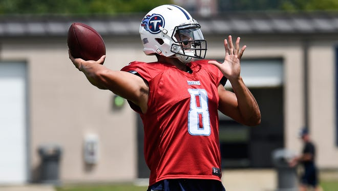 Titans quarterback Marcus Mariota (8) throws a pass during practice at St. Thomas Sports Park Tuesday Aug. 23, 2016, in Nashville, Tenn.