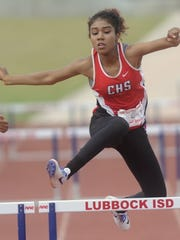 Cooper's Jacelyn Garrett races to victory in the 300-meter hurdles at the Region I-5A track and field meet Saturday, April 30, 2016 at Lowrey Field in Lubbock.