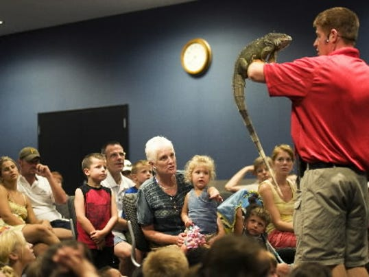 Jesse Rothacker and his iguana, Isadore, speak to a packed room at the Guthrie Memorial Library in 2010. He'll present a program Saturday at the Dig It! Faire. (FILE PHOTO)