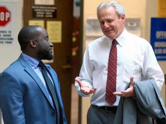Michael Morton talks with Assistant District Attorney Matthew Manning on Wednesday, May, 10, 2017, at the Nueces County Courthouse in Corpus Christi.