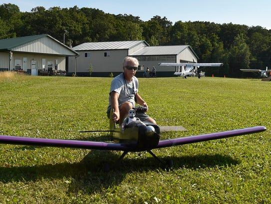 Ken Simonsen of the Green Bay Model Airplane Club prepares