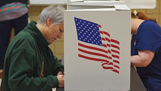 Heidi Wagner, of Sioux Falls, fills out her ballot during the 2016 Election Tuesday, Nov. 8, 2016, at the Kuehn Community Center in Sioux Falls.