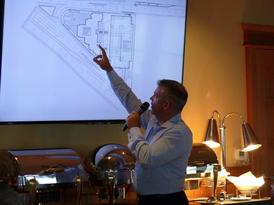 David Bartley Sr. (owner of Bartley Realty), who's was Trio's broker, shows where the proposed development is situated within the Gateway Triangle during a luncheon on July 21, 2016 with members of the East Naples Civic Association at Hamilton Harbor Yacht Club in East Naples.