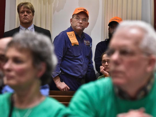 This 2015 file photo shows supporters and opponents during a public meeting at the Statehouse in Montpelier on a proposed bill that would expand background checks for gun sales. Opponents of the bill wore orange, while supporters wore green.