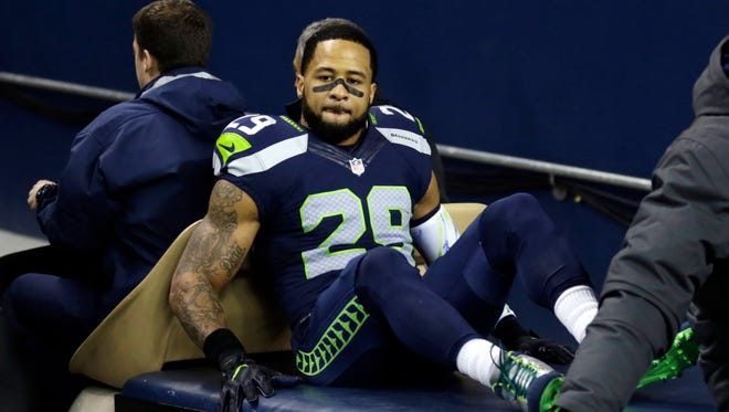 The Seattle Seahawks' Earl Thomas leaves the field on a cart after being injured against the Carolina Panthers on Dec. 4, 2016, in Seattle.