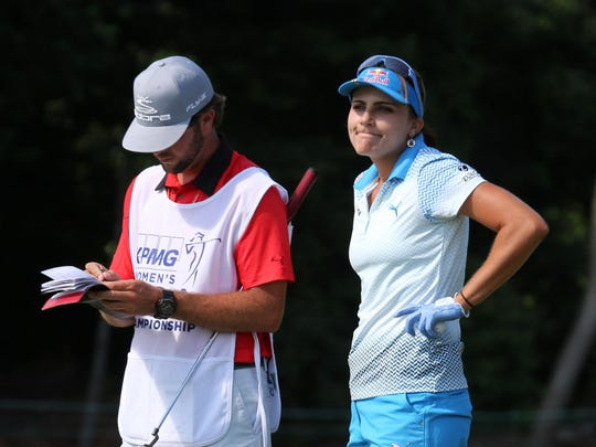 Lexi Thompson shows her disappointment as she stands next to her caddie Benji Thompson on the 15th green during action in the final round of the KPMG Women's PGA Championship at the Westchester Country Club in Harrison, June 14, 2015.