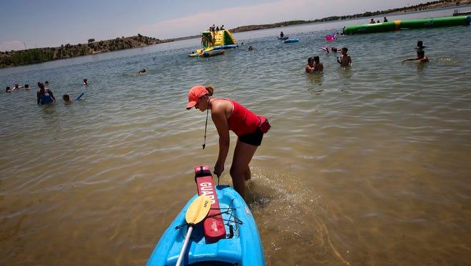 Lifeguard Emilee Lucero prepares for her patrol in her kayak on Monday at Farmington Lake.