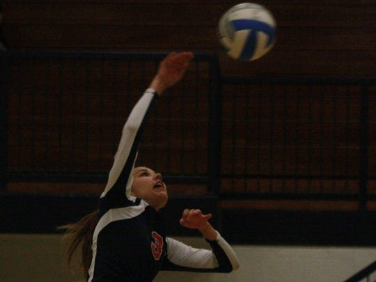 Franklin's Kelsey Krienitz takes a healthy swing at a perfect set Wednesday night.