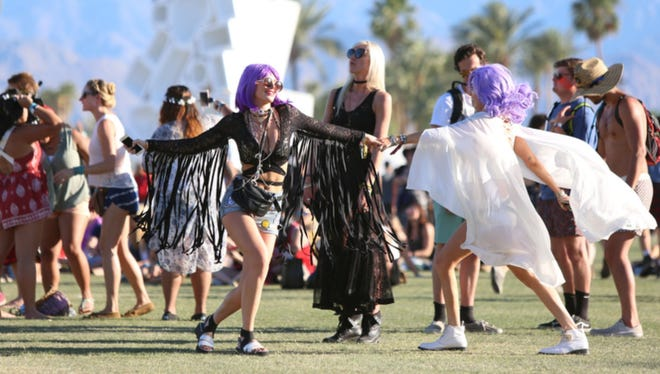Bella Thorne, left, and her sister Dani Thorne, both of Los Angeles dance to Matt and Kim during weekend one of the Coachella Valley Music and Arts Festival 2016.