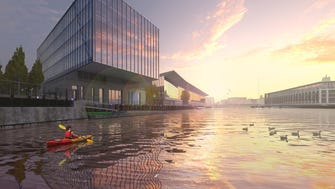 This artist's concept shows a riverfront office project being proposed for Milwaukee's Walker's Point area by Mandel Group Inc.