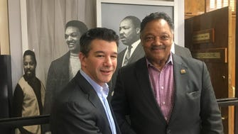 Uber CEO Travis Kalanick (l) and Jesse Jackson of the Rainbow PUSH Coalition (r) at the organization's headquarters in Chicago on March 23, 2017.