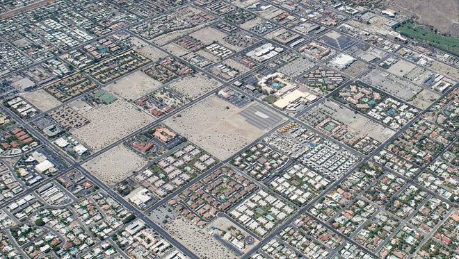 An aerial view shows the checkerboard pattern where development and non-development are side-by-side in certain areas of Palm Springs.