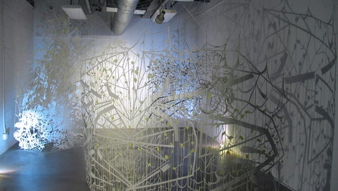 The Milwaukee native's exhibit, Between Light and Half Light, is an installation of cut paper drawings that plays with light and color.