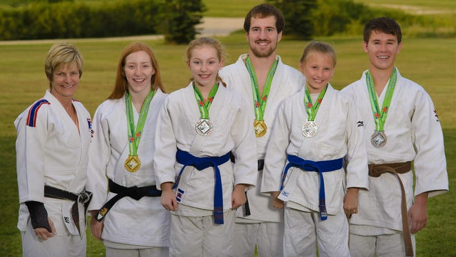 Club Olympia Judo team members are, from left: Coach Lynn Roethke, Lauren DeSmidt, Sophia DeSmidt, Grant Johnson, Rachel Cook, Spencer Depies. All five students took home awards after the July National Judo Championship.