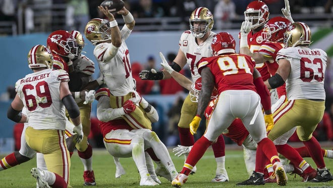 San Francisco 49ers quarterback Jimmy Garoppolo (10), is sacked late in the fourth quarter against the Kansas City Chiefs during Super Bowl LIV at Hard Rock Stadium in Miami Gardens, Feb. 2, 2020.