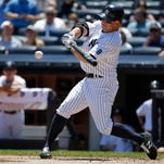 New York Yankees' Brett Gardner hits a single during the first inning of a baseball game against the Minnesota Twins Saturday, June 25, 2016, in New York.