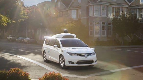 Image of a minivan in an intersection.