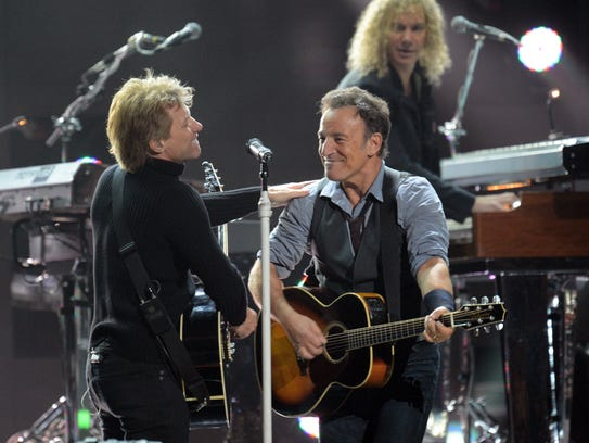 "Bruce Springsteen and Jon Bon Jovi perform during ""12-12-12"