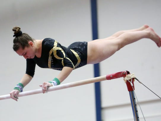 Lakeland/Panas' Jana Frattellone competes on the uneven
