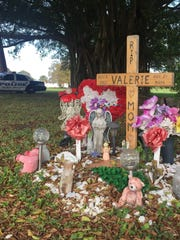 A memorial remains a year later near where Valerie Waters was hit by a vehicle Dec. 22, 2015, on Old Dixie Highway in Vero Beach. She died five days later.