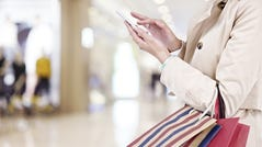 A woman using a mobile phone.