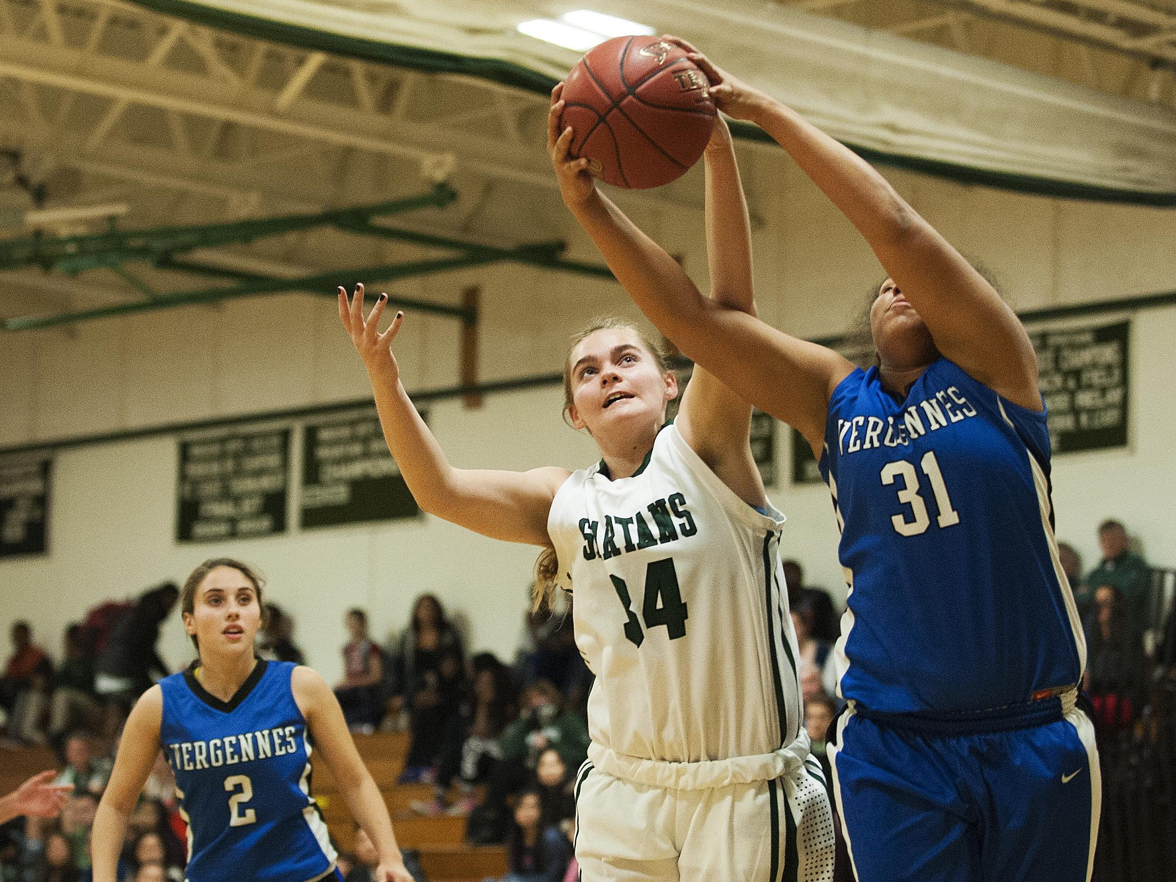 Vergennes' Nikkelette Salley, right, and Winooski's Mariah Metivier battle for the rebound during the girls basketball game between at Winooski High School on Wednesday night.