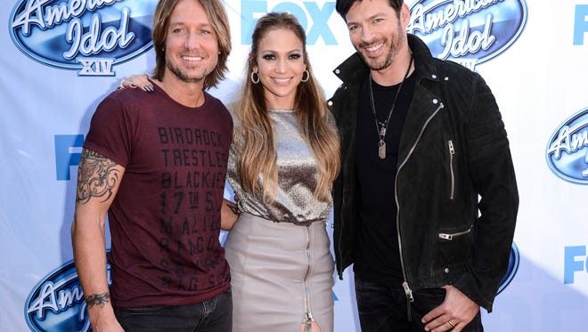 These are the current 'American Idol' judges, in case you still think Simon in on the show. (Photo by Dan Steinberg/Invision/AP, File)