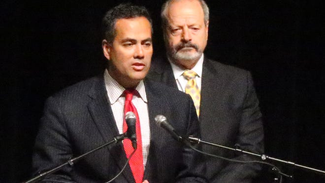 City Manager Tommy Gonzalez, left, is shown with Mayor Oscar Leeser.