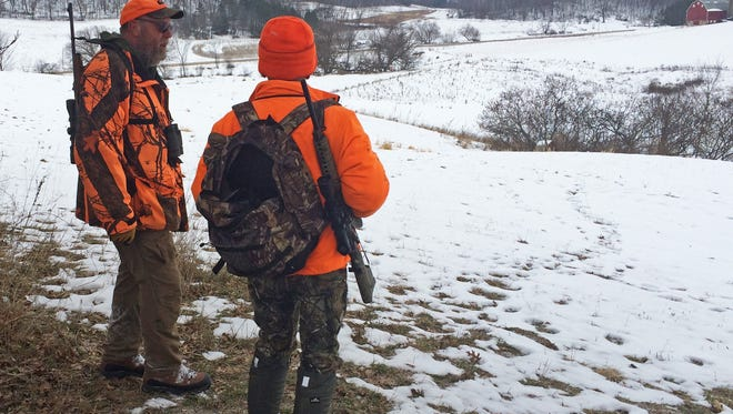 Doug Duren, left, talks with Dan Small after finishing a deer drive Dec. 29 in Richland County.