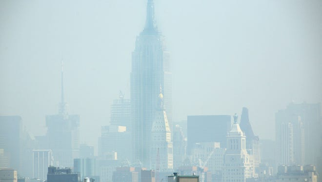 Smog covers midtown Manhattan in New York City on July 10, 2007.  Fourteen states and the District of Columbia announced a lawsuit against the Trump administration Thursday, alleging the EPA has failed to enforce smog standard rules developed during the Obama administration.