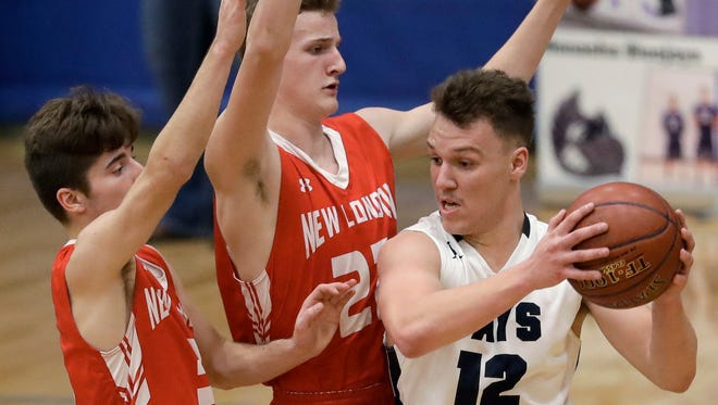 Menasha High School's #12 Brayden Kurth against New London High School's #3 Garret Locy and #22 Brennan Stroesenreuther during their Bay Conference boys basketball game on Thursday, February 1, 2018, in Menasha, Wis.