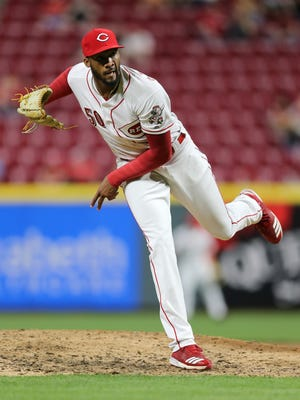 Cincinnati Reds relief pitcher Amir Garrett (50) follows through on a delivery in the sixth inning during the National League baseball game between the St. Louis Cardinals and the Cincinnati Reds, Thursday, April 12, 2018, at Great American Ball Park in Cincinnati.