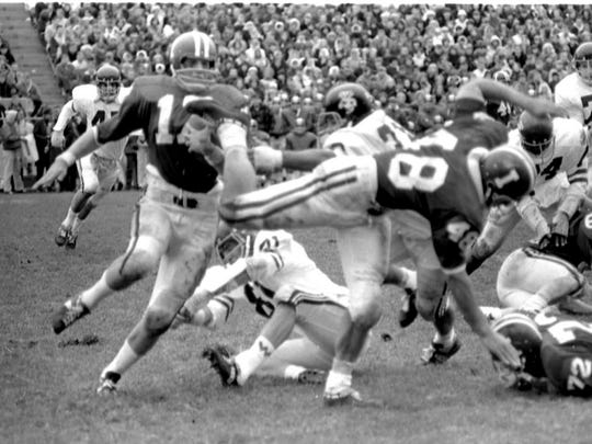 John Isenbarger follows the block of a teammate against Wisconsin in 1967.