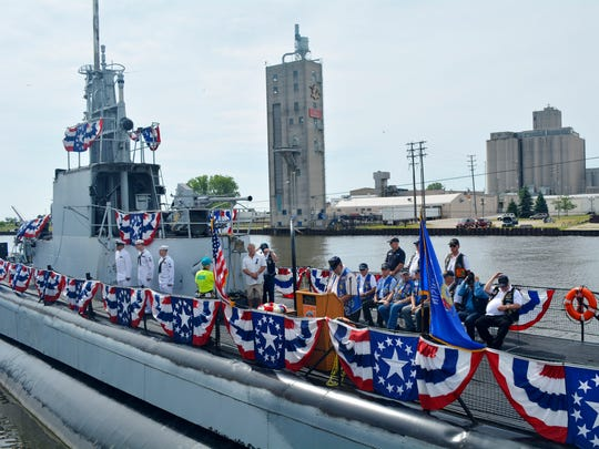 Members of the Wisconsin Submarine Veterans Base begin a Tolling of the Boats ceremony on the deck of the USS Cobia on Sunday. The ceremony honored the boats deployed and the submariners lost throughout U.S. military history.
