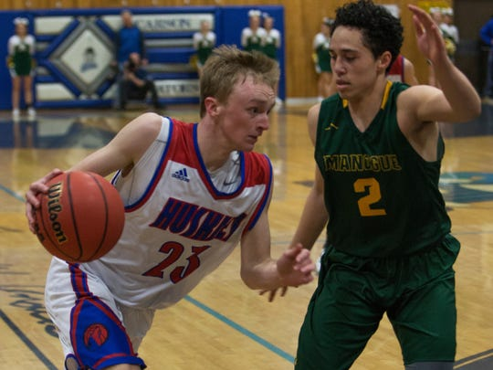 Reno's Drew Rippingham drives past Manogue's Gabe Bansuelo in the Regional Championship Basketball game held at Carson  High School on  February 18, 2017.