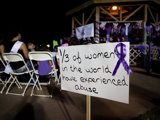A sign showing the statistics of women who have experienced domestic abuse at COPE's vigil last year at Alameda Park.