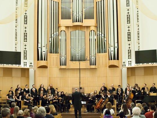 Matthew Blegen leads the Great Bend Chorale adult choir